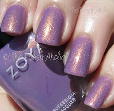 Zoya Zara is a dusty light purple with a fab copper shimmer