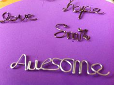 Handmade wire word charms by Swirlsgiftsandtreats on Etsy, $4.00