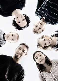 family portrait idea, but maybe with arms around each other. cool angle :)