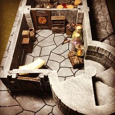 Looks like a quite simple dungeon done with cardboard (foam?). But take a closer look at the details and dressing.