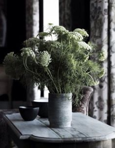 A vase of fresh cuttings. A minimal, organic, rustic, modern, serene, slow living style vibe.