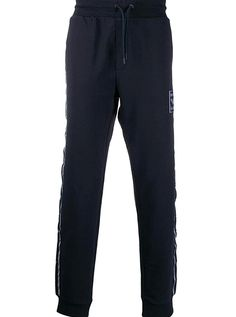 This season you will be amazed at Emporio Armanis newest collection. Created to provide you with timeless designs for years to come you will definitely enjoy the brands elegant and comfortable outfits. These dark blue cotton blend logo stripe track pants from Emporio Armani were designed with your comfort in mind. Featuring an elasticated drawstring waist side pockets a rear pocket a logo stripe detail to the side a front logo patch and a cuffed leg. Armani Logo, Comfortable Outfits, Timeless Design, Emporio Armani, Drawstring Waist, Most Beautiful Pictures, Dark Blue, Track, Seasons