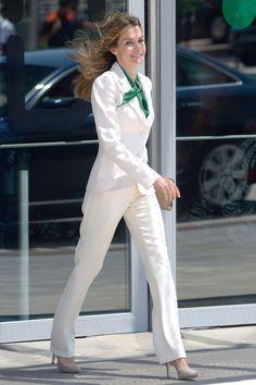 July 2012 Queen Letizia wears an emerald green blouse that pops against a crisp white suit