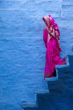 Woman on stairs, Jodhpur, Rajasthan, India by Jim Zuckerman .. I want this saree!! What a beautiful color.