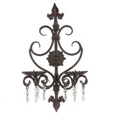 Wrought iron candle sconce with crystal accents.   Product: Candle sconceConstruction Material: Wrought iron  Color: Black  Features: Crystal accent beadsAccommodates: (2) Candles - not includedDimensions: 19 H x 11.5 W x 6.5 D