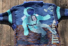 "My crocheted ""One Small Step, One Giant Leap"" sweater in honor of astronaut  Neil Armstrong. This is the back."
