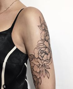 In love with this floral arm tattoo
