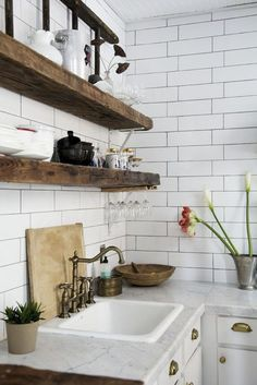 Rustic shelves, white subway tile, grey/white marble counters