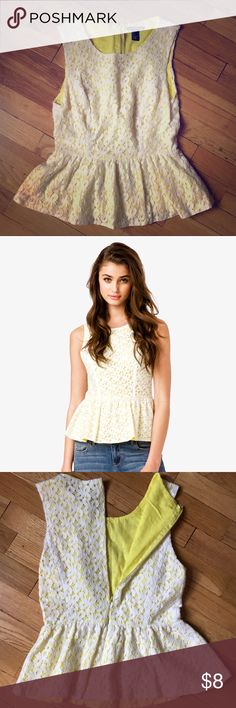 Forever 21 lace peplum top Forever 21 white lace with yellow backing peplum top. It zips up the back since it has no stretch. Forever 21 Tops Tank Tops