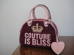 """WONDERFUL Vintage Baby Pink and Mauve Bowling Bag Style SATCHEL  This is a Juicy Couture is Bliss!!  Pink Handbag. It has Pink leather straps. This item was purchased new at a Juicy Couture store.  It is an Authentic item.  Color: Pink Style: Bowling Bag  Height: 7"""" TALL Bag Depth: 5"""" WI..."""