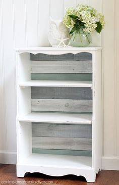 I REDID A BOOKSHELVE LIKE THIS, ONLY IT WAS TWICE THE SIZE. THE PAPER ON THE BACK CAME FROM JOANNS...REDFOX