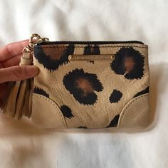 Rebecca Taylor leather mini purse Bought at Rebecca Taylor website. It wasn't used much. Inside: great condition Outside: good condition. Size: 5.5W x 4H x .5D Rebecca Taylor Bags Cosmetic Bags & Cases