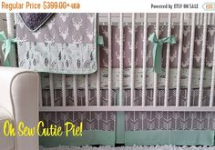 "Timeless, classy and so trendy! This amazing collection of prints it perfect for your new baby! So many possibilities with shades of grey, teal or come up with your favorite color scheme! This set will include the following....  1 Cotton sheet 1 Crib Skirt (3 sided) Flat design with accent & peekaboo trimmings. 1 Baby/Crib sized blanket (approx. 34 x 43"") with header & footer and matching minky backing. Monogram included!! 1 Bumper set with piping & ties - Flat style (approx 1"" thick)"