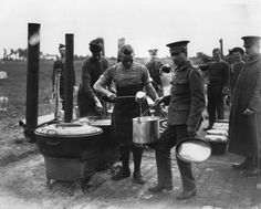 A soldier from the London Scottish Regiment serves soup at a camp on the Western Front