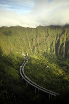 H3 Highway from Honolulu to Kaneohe, Hawaii.  You drive straight through these beautiful mountains and come out on the other side for the view of a lifetime.