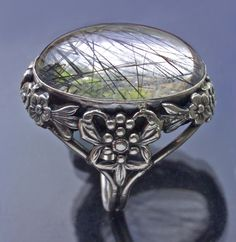 this rutilated quartz ring is listed as being in the £750-1000 range. anyone want to buy it for me?