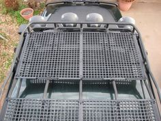 PolyMax Poultry/Kennel Flooring from Farmtek used for roof rack flooring. Strong enough to stand on. Comes in 2'x4' rectangles for $22 from Farmtek. Get the non-overlapping kind. http://www.farmtek.com/farm/supplies/ProductDisplay?catalogId=15052&storeId=10001&langId=-1&division=FarmTek&productId=20251