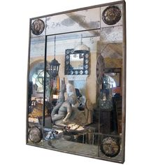 """Lovely Bullseye mirror. These mirrors are designed and made locally by R.T. Facts. Mirrors set into a zinc wrapped wood frame. Features a hanging mechanism on the back to be hung individually. Built to suit, price may vary.  48.5″H x 37""""w"""
