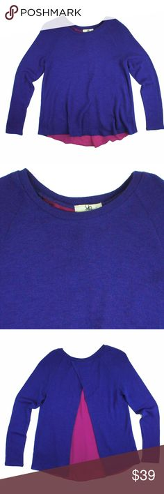 "New YA LOS ANGELES Cobalt Layered Sweater This new Colbalt blue sweater from YA features a relaxed fit. It has a woven fuschia under layer for a pop of color. The back of the sweater crosses over behind the neck revealing the fuschia under layer. Adorable! Made of a cotton blend. Measures: bust: 37"", total length: 26"", sleeves: 24"" Ya Los Angeles Sweaters Crew & Scoop Necks"