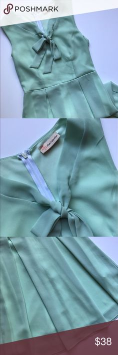 Mint green dress with bow detail Worn once! This super cute mint dress was originally from Modcloth. Zip closure on back. Fully lined. Great condition! Like new! ModCloth Dresses Midi