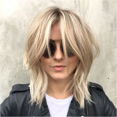 This shaggy blonde 'do is perfect for spring + summer.