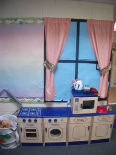 Bring an essential component of your children's development into the home or classroom with this home corner role play pack. Class Displays, School Displays, Classroom Displays, Classroom Organisation, Play Corner, Corner House, Kitchen Corner, Home Corner Ideas Early Years, Role Play Areas Eyfs