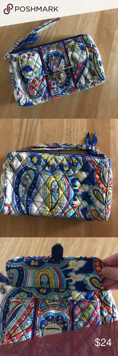 """Vera Bradley Marina Paisley Pushlock Wristlet Vera Bradley Marina Paisley Pushlock Wristlet. Authentic Vera Bradley retired pattern Marina Paisley wristlet has a push-lock pocket on the exterior. Interior has one zip pocket and four card slots. Measurements: 8.25W x 5.5H x 1.5D with 3"""" handle drop. This bag has been used a few times but is in excellent condition and no signs of wear or tear. Feel free to ask questions. No trades. Vera Bradley Bags Clutches & Wristlets"""