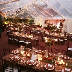 A clear tent strung with twinkling lights set a romantic atmosphere. - I like the long tables this way.