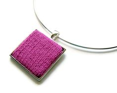 Square Necklace Fuchsia on Silvered Base Knitted with Acrylic Wool. $22.00, via Etsy.A rainbow of colors make this necklace a can't go wrong item! I love this. And yup... the red one is MINE... keep your hands off it! ;)