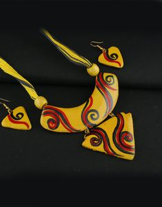 Yellow Colour Fancy Terracotta Designs Stylied With Printed Print Handmada Terracotta Jewellery