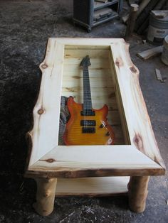 Wow, that is neat... Could put anything inside; car parts, holiday stuff, gun, sword, ect.  I actually have an old guitar that would look great displayed like this in the #mancave.