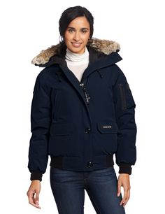 Canada Goose Women's Chilliwack Bomber, Navy, X-Small. 195 gm Arctic Tech; 85% Polyester/15% Cotton with DWR finish; lining - 55 gm Nylon plains weave treated with DWR finish. Bomber length for exceptional mobility. Removable Coyote fur ruff surrounding an adjustable hood. Canada.