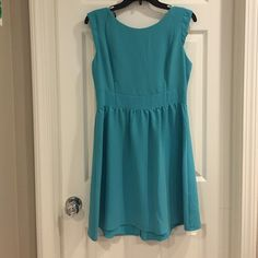 Adorable aqua colored dress with cap sleeves In great condition. Worn for a photo. Length 32.  Pit to pit 17 inches. Waist 14.5 inches flat. Very cute with riding boots, sandals, etc. Forever 21 Dresses