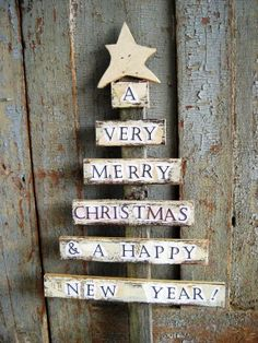 A Very Prim Christmas wooden tree sign. - this gives me ideas... wooden Popsicle sticks with ribbon to attach them... maybe