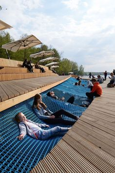 Lake shore redevelopment features over-water hammocks | Tychy | Poland See the full project http://bit.ly/1jUHOWF