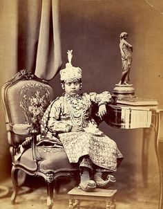 A young girl from an Indian princely family, c. 1870.  After British imperial rule in India was established in 1858 the numerous kingdoms or states were divided into three main divisions with 565 kingdoms in total. The states varied in size and significance; some covered thousands of square miles, others barely covered a square mile. With Independence in 1947 the princely states merged into the republic of India and in 1971 they were de-recognised by the Republic of India.