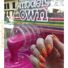 I did these super-bright nails using all 5 of @modelsownofficial Polish For Tans new collection which they were kind enough to send me  here's a pic of them posing in front of a Bottleshop!! #nails #nailart #mani #manicure #nails #nailsoftheday #nailsofinstagram #nailstagram #notd #nails2inspire #craftyfingers #summernails #polishfortans  #longnails #almondnails #stilettonails #nailspiration #leopardprintnails #gradientnails