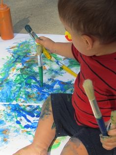 Painting with a toddler | Teach Preschool-fantastic example of a process oriented art experience.