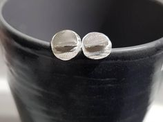 Check out this item in my Etsy shop https://www.etsy.com/listing/571814095/simple-circles-stud-earrings-hammered