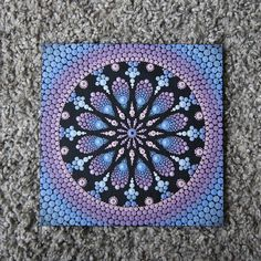 Canvasboard of 0.4 mm thick painted with acrylic paint with mandala. The size is 20 x 20 cm. The idea with dots en mandala is inspirited by Elspeth McLean. Shipping the painting within 1-3 days with Track & Trace code. Colors on the pictures can deflect from reality. This because every