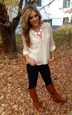 Loose curls, bog necklace, sheer tan button up, black jeans, tall brown boots|