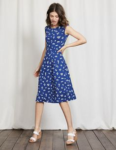 Get ready to meet your new, favourite, wear-it-absolutely-anywhere dress. It's crafted from soft and stretchy fabric in a flatteringly feminine shape, with a fitted top and full skirt that's perfect for swooshing. And let's not forget that striking sailor-inspired print and boat neckline.