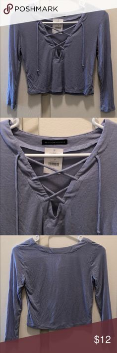 NEW Brandy Melville Lace Up 3/4 Sleeve Crop Light blue/purple lace up crop. NEW! Brandy Melville Tops Crop Tops