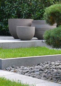 Giant planters as bold accents for a garden.