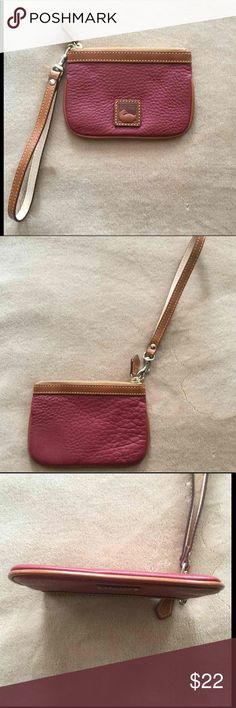 """Dooney Bourke Leather Cranberry Wristlet Beautiful Wristlet with no wear or damage. Super soft pebbled leather, maybe Dillen leather?  I think it is the color Cranberry. Includes wrist strap.  6 1/4"""" long x 4 3/8"""" high. Smoke free home. Dooney & Bourke Bags Clutches & Wristlets"""