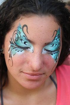 Blue butterfly face paint-- I would do one eye like this then alter the other to make it asymmetrical. So I guess I think this is pretty, but not for the butterfly aspect.
