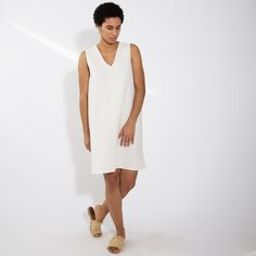 Easy sleeveless dress with a reversible neckline.
