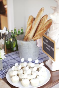 french theme party in paris.  love the baguette in the tin as decoration