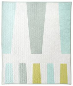 For babies and pets and walls, alike! Multicolored trapezoidal shapes - 3 large in one row; 5 small in separate, facing row. Soft white separates each. Ice blue, seafoam (soft grey/green) and zucchini (yellow/green). 33x39 Machine pieced and quilted. Machine wash + dry (gentle, cold