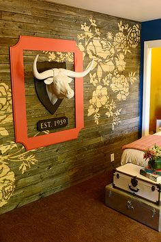 Hy's Room by Ree Drummond / The Pioneer Woman, via Flickr. The barnwood wall decor was etched in with a CNC machine. It's gorgeous!